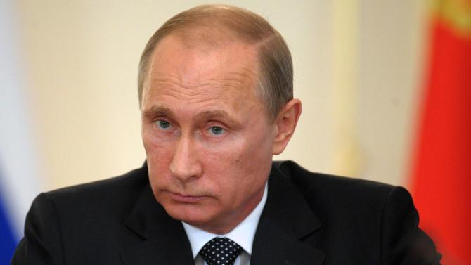 """Russian President Vladimir Putin chairs a government meeting that focused on economic and social issues in the Novo-Ogaryovo residence outside Moscow, Russia, Wednesday, June 11, 2014. Ukraine on Wednesday rejected Russia's offer of discount for gas shipments, which President Vladimir Putin touted as a """"partnership deal."""" (AP Photo/RIA-Novosti, Alexei Druzhinin, Presidential Press Service)"""