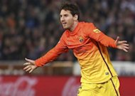 Barcelona&#39;s Lionel Messi celebrates his goal against Granada during their Spanish first division soccer match at Los Carmenes stadium in Granada February 16, 2013. It was his 300th goal for Barcelona. REUTERS/Pepe Marin