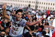 "A man shouts slogans he takes part in a protest against militias with thousands of others in Benghazi on September 21. Worried Libyan authorities called on the demonstrators to distinguish between ""illegitimate"" brigades and those who are under state control"