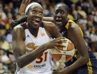 Connecticut Sun's Tina Charles, left, drives to the basket while guarded by the Indiana Fever's Jessica Davenport, right, in the second half of a WNBA basketball game in Uncasville, Conn., Wednesday, Sept. 19, 2012. Connecticut won 73-67. (AP Photo/Jessica Hill)