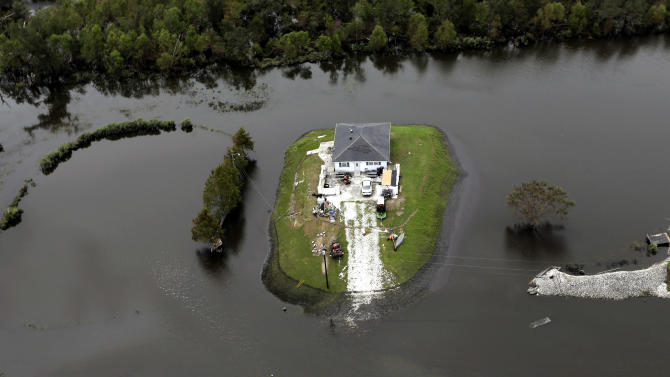 A home is surrounded by floodwaters from Isaac in Reggio, La., Friday, Aug. 31, 2012. Isaac is now a tropical depression, with the center on track to cross Arkansas on Friday and southern Missouri on Friday night, spreading rain through the regions. (AP Photo/David J. Phillip)