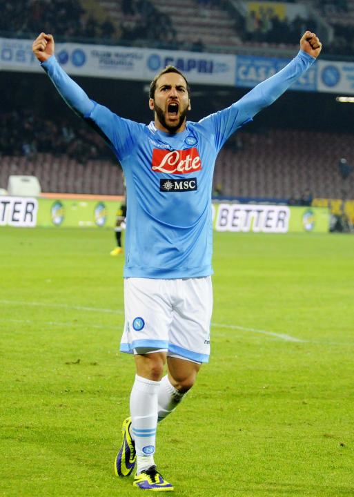 Napoli's Gonzalo Higuain celebrates after scoring during a Serie A soccer match between Napoli and Udinese, at the San Paolo stadium in Naples, Italy, Saturday, Dec. 7, 2013. The match ended 3-3