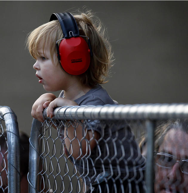 Lennon Roland, 2, watches cars zip by during an American Le Mans Series practice round for the IndyCar Baltimore Grand Prix auto race on Friday, Sept. 2, 2011, in Baltimore. (AP Photo/Patrick Semansky
