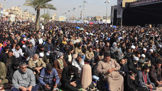 Followers of Shiite cleric Muqtada al-Sadr attend Friday prayers in the Shiite stronghold of Sadr City in Baghdad, Iraq, Friday, Feb. 1, 2013. (AP Photo/ Karim Kadim)