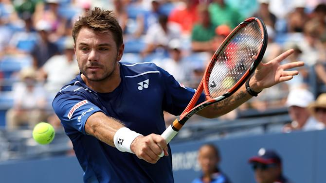 Stan Wawrinka, of Switzerland, returns a shot to Hyeon Chung, of South Korea, during the second round of the U.S. Open tennis tournament, Thursday, Sept. 3, 2015, in New York. (AP Photo/Adam Hunger)