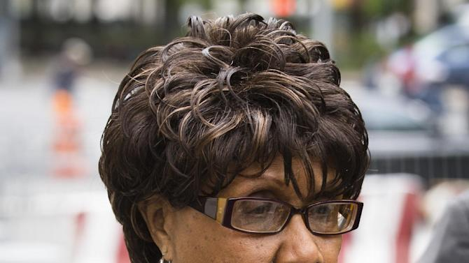 Former New York state senator Shirley Huntley arrives at Brooklyn federal court for sentencing after pleading guilty to embezzlement charges, Thursday, May 9, 2013, in New York. The 74-year-old secretly recorded other politicians in a bid for leniency for her role in a corruption scandal and faces up to two years in prison.(AP Photo/John Minchillo)
