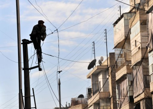 A Syrian man attempts to fix the electricity cables in the northern city of Aleppo on February 14, 2013. A new peace plan for Syria, involving the creation of a senate to oversee a power transition, is currently making the rounds in the United Nations, Saudi newspaper Asharq Alawsat reported