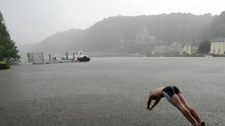 "A green activist dives into a river in support of the ""Big Jump"" project, in Jambes"