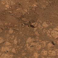 "This image from the panoramic camera on NASA's Mars Exploration Rover Opportunity shows where a rock called ""Pinnacle Island"" had been before it appeared in front of the rover in early January 2014. This image was taken on Feb. 4, 2014."