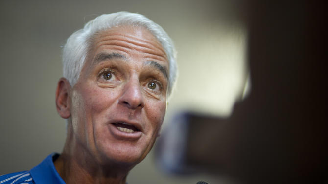 FILE - This Aug. 26, 2014, file photo shows Former Republican Gov. Charlie Crist as he speaks during a campaign stop in Boynton Beach, Fla. Becoming a governor can take years of paying political dues and a grueling nomination battle. Once it's gotten, keeping the power tends to be easier. Incumbents are tough to beat, particularly when the economy is on the upswing. That's the case this year when 36 states pick governors. (AP Photo/J Pat Carter, File)