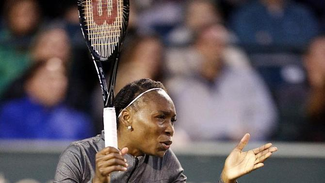 Venus Williams reacts to a shot against Monica Puig, of Puerto Rico, during their match at the Family Circle Cup tennis tournament in Charleston, S.C., Wednesday, April 3, 2013. (AP Photo/Mic Smith)