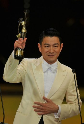 Hong Kong actor Andy Lau reacts after winning the Best Actor award