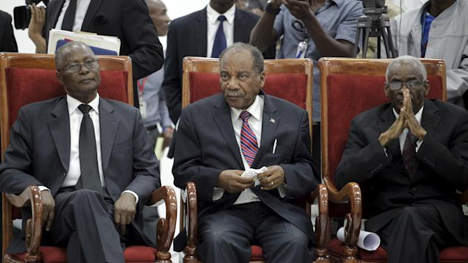 Provisional president candidates Jocelerme Privert, Dejean Belizaire and Edgar Leblanc Fils attend the Special Bicameral Commission for the election of the provisional President of the Republic in the Haitian Parliament in Port-au-Prince, Haiti