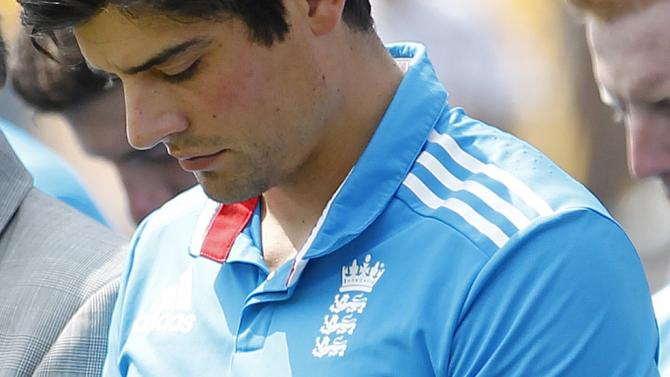 England's captain Alastair Cook wears a black armband as a tribute to Australian cricketer Phillip Hughes, who died on Thursday, before the start of the second one-day International (ODI) cricket match against Sri Lanka in Colombo