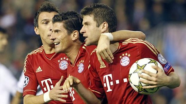 Thomas Muller (R) is congratulated by his team mates Mario Gomez (C) and Mario Mandzukic (Reuters)