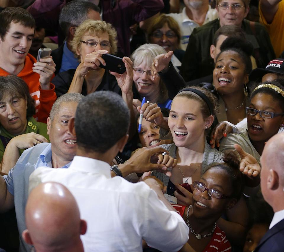 President Barack Obama greets supporters after speaking at a campaign event at Bowling Green State University, Wednesday, Sept. 26, 2012, in Bowling Green, Ohio. (AP Photo/Pablo Martinez Monsivais)