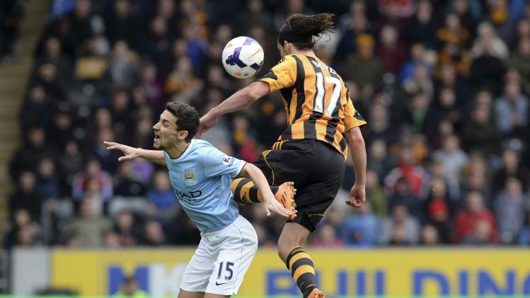 Hull City's Boyd challenges Manchester City's Navas during their English Premier League soccer match at the KC stadium in Hull