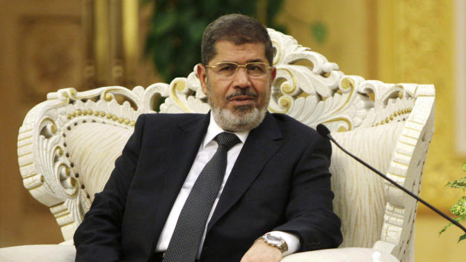 Egypt's President Mohammed Morsi meets with Chinese Vice President Xi Jinping, unseen, at the Great Hall of the People in Beijing Wednesday, Aug. 29, 2012. Morsi was in China on a three-day visit since Tuesday. (AP Photo/How Hwee Young, Pool)