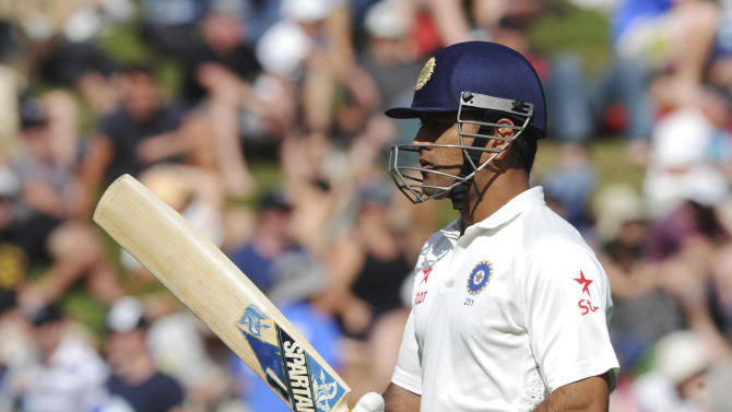 India's MS Dhoni departs for 68 off the bowling of New Zealand's Trent Boult on the second day of the second cricket test in Wellington, New Zealand, Saturday, Feb. 15, 2014. (AP Photo/SNPA, Ross Setford) NEW ZEALAND OUT