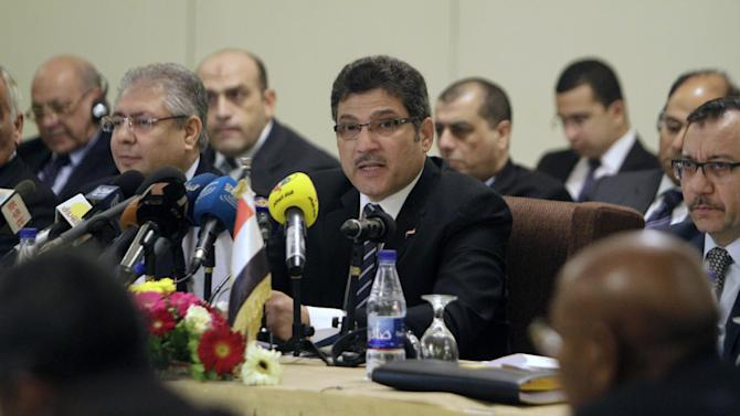 Egyptian Minister of Irrigation, Hossam Maghazi (C), speaks during a Nile River forum with his Sudanese and Ethiopian counterparts in the Sudanese capital Khartoum on August 25, 2014