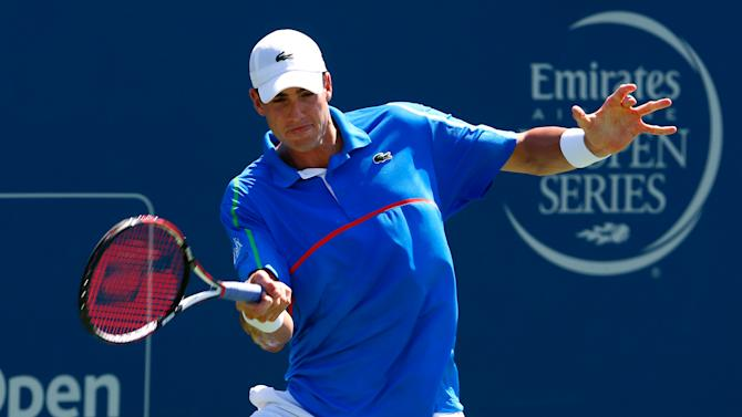 John Isner returns a forehand to Jack Sock during their Atlanta Open match in Atlanta, Georgia on July 26, 2014