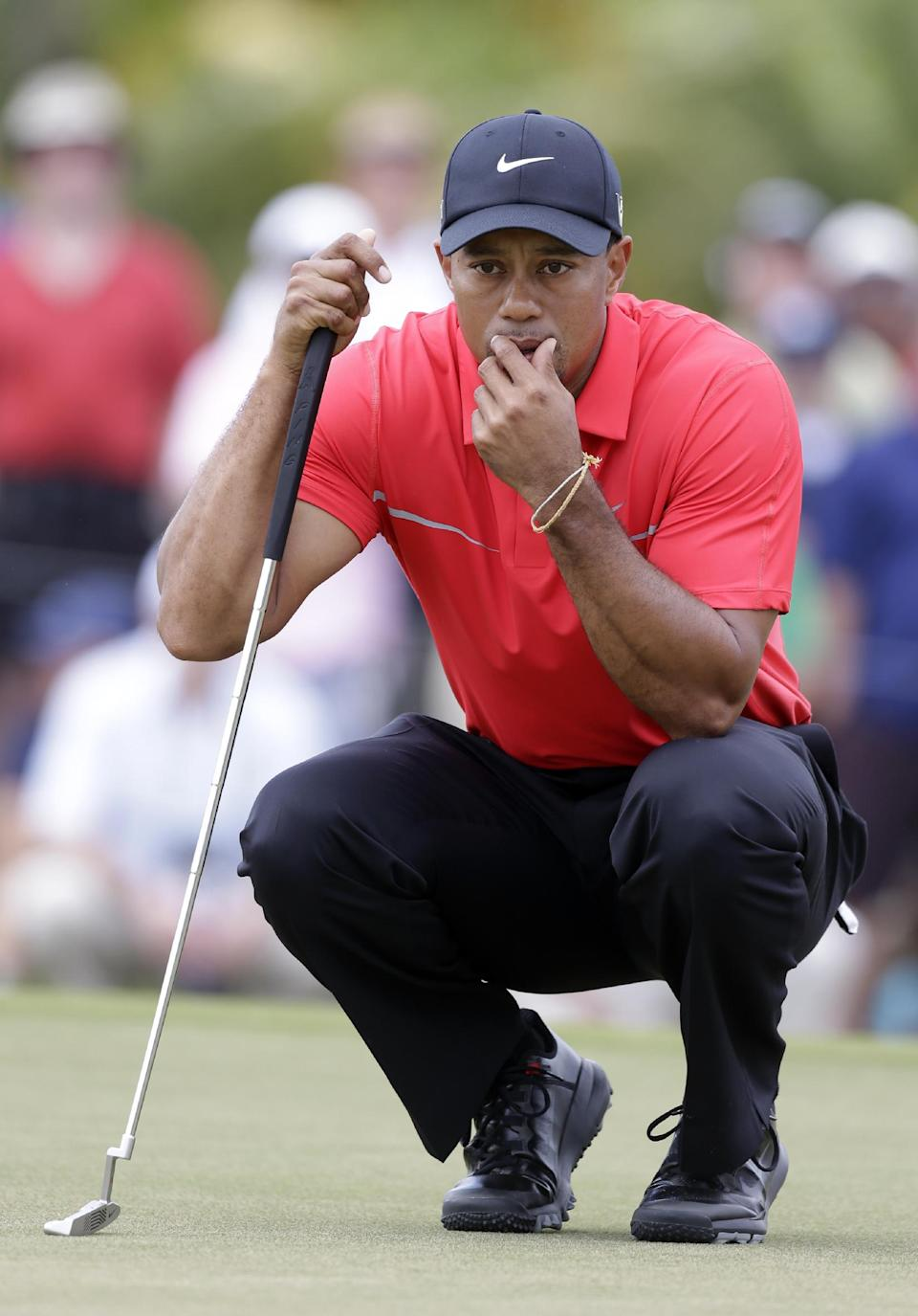 Tiger Woods looks at his shot on the fourth green during the third round of the Cadillac Championship golf tournament on Sunday, March 10, 2013, in Doral, Fla. (AP Photo/Wilfredo Lee)