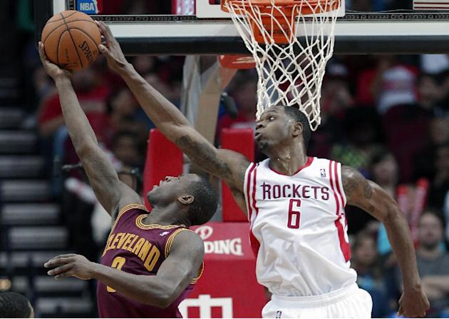 Houston Rockets' Terrence Jones (6) reaches out to block a shot by Cleveland Cavaliers' Dion Waiters (3) in the second half of an NBA basketball game Saturday, Feb. 1, 2014, in Houston. The Ro