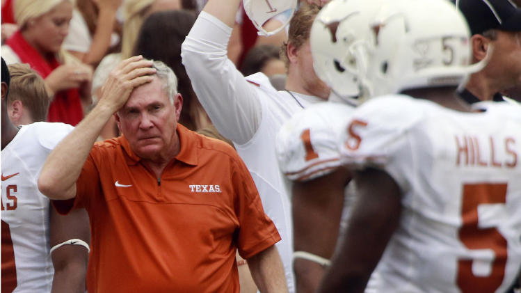 Texas head coach Mack Brown reacts on the sidelines during the first half of an NCAA college football game against Oklahoma at the Cotton Bowl Saturday, Oct. 13, 2012, in Dallas. (AP Photo/Michael Mulvey)