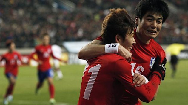 South Korea's Son Heung-min (L) celebrates with his teammate Ki Sung-Yueng after scoring a goal against Qatar during their World Cup qualifying game