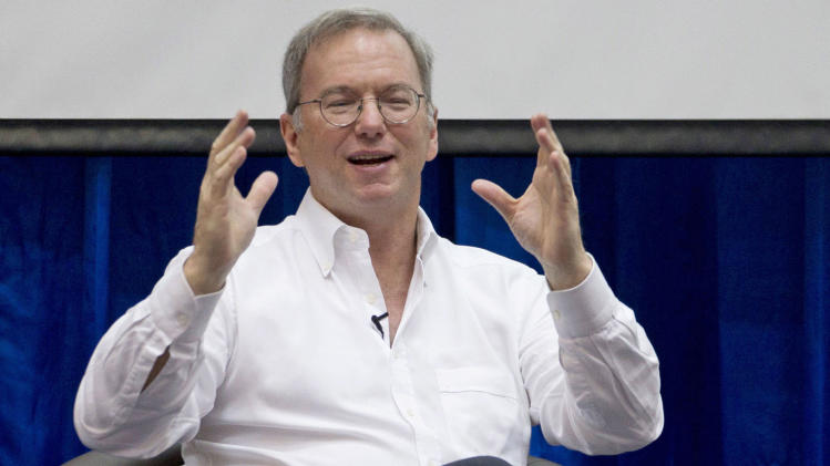 "FILE - In this Friday, March 22, 2013, Google Executive Chairman Eric Schmidt gestures during  an interactive session with group of students at a technical university in Yangon, Myanmar .  Schmidt said ""the future is now"" for YouTube, which recently passed the milestone of 1 billion unique visitors every month. But, he added with the Third World in mind, if you think that's a large number, ""wait until you get to 6 (billion) or 7 billion."" (AP Photo/Gemunu Amarasinghe, file)"