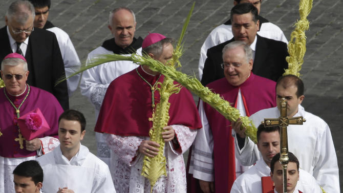 Pope Francis arrives to celebrate an open-air Palm Sunday Mass  in St. Peter's Square at the Vatican, Sunday, March 24, 2013. Palm Sunday commemorates Jesus Christ's triumphant entry into Jerusalem, and is the start of the church's Holy Week. (AP Photo/Alessandra Tarantino)
