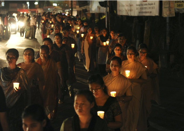 In this Wednesday, Dec. 12, 2012 photograph, people participate in a candle light rally in Mangalore, India to pay their respects to nurse Jacintha Saldanha, who killed herself in London after taking