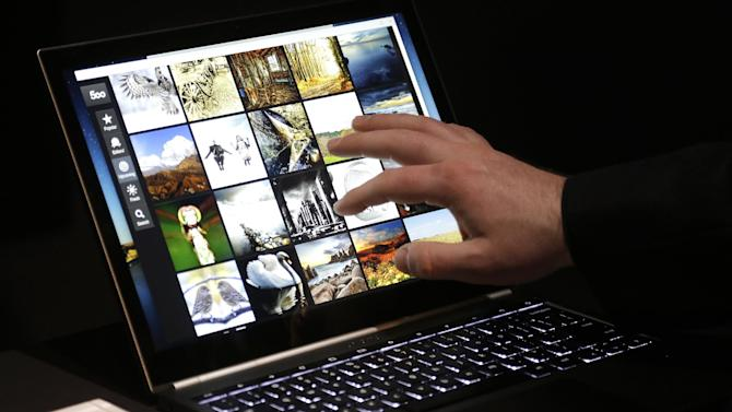 A man uses the Google Chromebook Pixel laptop computer after an announcement in San Francisco, Thursday, Feb. 21, 2013. Google is adding a new touch to its line of Chrome laptops in an attempt to outshine personal computers running on software made by rivals Microsoft and Apple.  (AP Photo/Jeff Chiu)