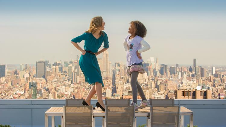 "This image released by Columbis Pictures shows Rose Byrne, left, and Quvenzhané Wallis in a scene from ""Annie."" (AP Photo/Columbia Pictures - Sony, Barry Wetcher)"