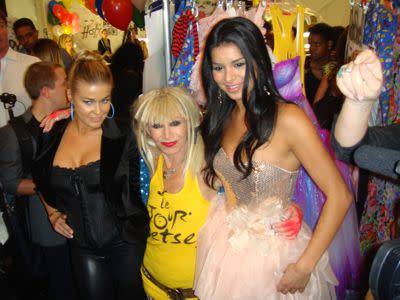 Betsey poses with celeb fans backstage like Carmen Elektra and Miss USA. Kelly Osbourne, Ciara, and many other stars were also seated front row.