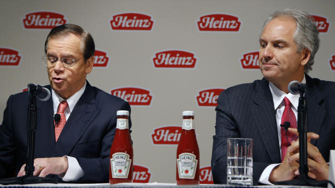 H.J. Heinz Co. CEO William Johnson, left, and 3G Capital Managing Partner Alex Behring speak at a news conference at the world headquarters of the H.J. Heinz Co. on Thursday, Feb. 14, 2013, in Pittsburgh. Billionaire investor Warren Buffett's Berkshire Hathaway and its partner on the deal. 3G Capital, are  dipping into the ketchup business as part of a $23.3 billion deal to buy the Heinz ketchup company. (AP Photo/Keith Srakocic)