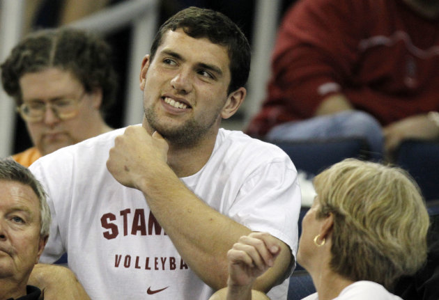 Former Stanford quarterback Andrew Luck sits in the stands before finals of the NCAA women's gymnastics championships, Saturday, April 21 2012, in Duluth, Ga., . (AP Photo/John Bazemore)