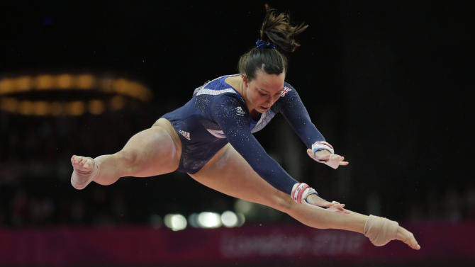 Britain's gymnast Elizabeth Tweddle performs on the uneven bars during the artistic gymnastics women's apparatus finals at the 2012 Summer Olympics, Monday, Aug. 6, 2012, in London. (AP Photo/Gregory Bull)