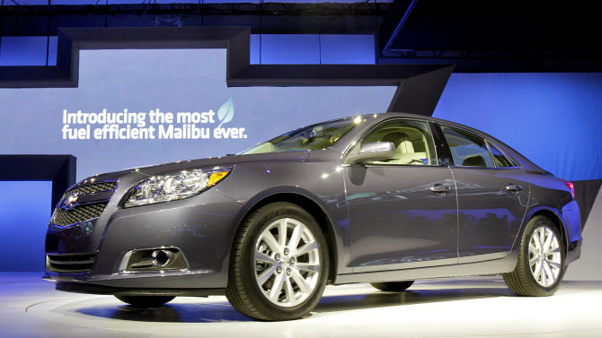 The 2013 Chevrolet Malibu Eco is introduced at the New York International Auto Show, Wednesday, April 20, 2011. Chevrolet is trying to pull more customers into its dealerships this summer by offering a money-back guarantee on new cars and trucks.  (AP Photo/Richard Drew)