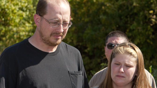 The parents of missing 10-month old Lisa Irwin, Jeremy Irwin and Deborah Bradley, speak during a news conference in Kansas City, Mo., Wednesday afternoon, Oct. 5, 2011. The parents made a tearful plea for the child's safe return Wednesday, nearly two days after she disappeared, begging her abductor to drop her off someplace safe. (AP Photo/The Kansas City Star, Mike Ransdell)