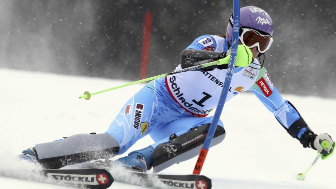Slovenia's Tina Maze clears a gate during the first run of the women's slalom, at the Alpine skiing world championships in Schladming, Austria, Saturday, Feb.16, 2013. (AP Photo/Alessandro Trovati)