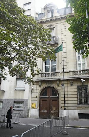 A security member stands at the entrance of the Saudi Arabia embassy in Paris, Monday Aug. 18, 2014. Paris police say that armed robbers ambushed and stole a car belonging to a Saudi prince at a highway interchange on the northern edge of the French capital. Police official said Monday that there were no injuries in the attack Sunday night by multiple assailants. (AP Photo/Remy de la Mauviniere)