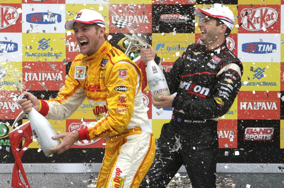 IndyCar driver Will Power, of Australia, right, celebrates his victory at the winner's podium with  Ryan Hunter-Reay, of the U.S, who places second, in the IndyCar Sao Paulo 300, in Sao Paulo, Brazil, Sunday, April 29, 2012. (AP Photo/Andre Penner)