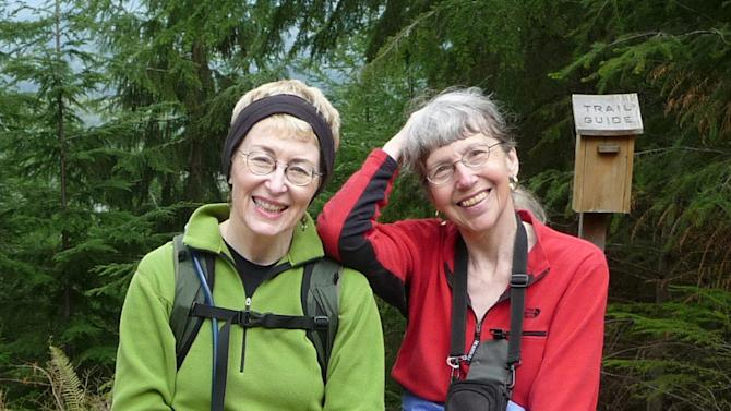 This undated image provided by Lola Kemp shows missing hiker Karen Sykes, right, with her friend Lola Kemp. Crews searched Mount Rainier National Park on Friday June 20, 2014, for Sykes, a prominent hiker and outdoors writer who was reported missing late Wednesday. She was working on a story at the time, park spokeswoman Patti Wold said. (AP Photo/Lola Kemp)