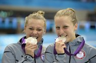 US Silver medalists Kelci Bryant, left, and Abigail Johnston pose with their medals during the 3 Meter Synchronized Springboard final at the Aquatics Centre in the Olympic Park during the 2012 Summer Olympics in London, Sunday, July 29, 2012. (AP Photo/Mark J. Terrill)