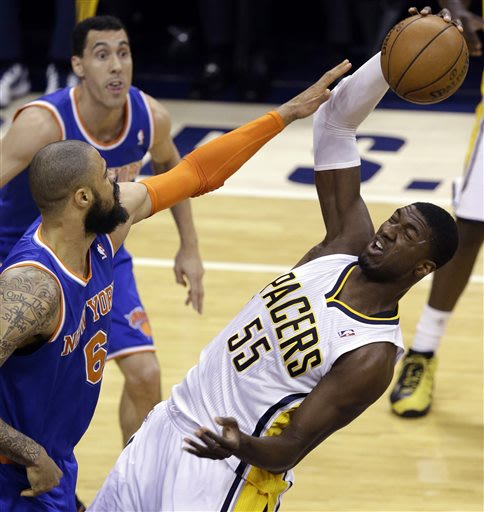 Indiana Pacers center Roy Hibbert, right, is fouled by New York Knicks center Tyson Chandler (6) when grabbing a rebound during the first quarter of Game 6 of the Eastern Conference semifinal NBA bask