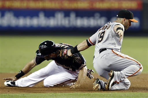 Rookie LHP Corbin has 4 RBIs in Arizona rout of SF