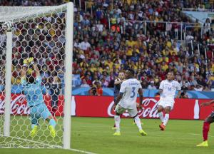 France's Karim Benzema, second from left, scores…