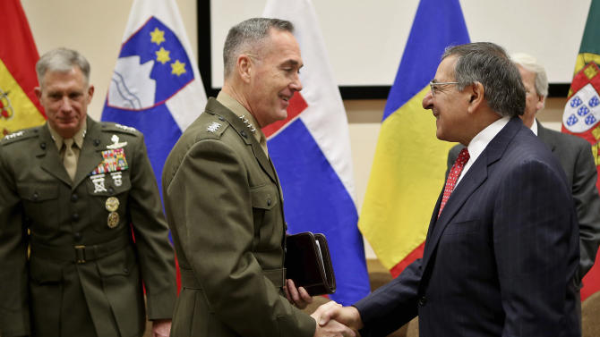 International Security Assistance Force (ISAF) Commander Gen. Joseph Dunford, center, greets outgoing U.S. Secretary of Defense Leon Panetta following their arrival at NATO headquarters, Brussels, Thursday, Feb. 21, 2013. Panetta is in Brussels Thursday to attend a NATO Defense Ministers Meeting. (AP Photo/Chip Somodevilla, Pool)