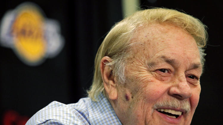 FILE - In this Aug. 17, 2010, file photo, Los Angeles Lakers owner Jerry Buss smiles during an NBA basketball news conference in Bell Gardens, Calif. Buss, the Lakers' playboy owner who shepherded the NBA franchise to 10 championships, has died in Los Angeles. He was 79. (AP Photo/Damian Dovarganes, File)